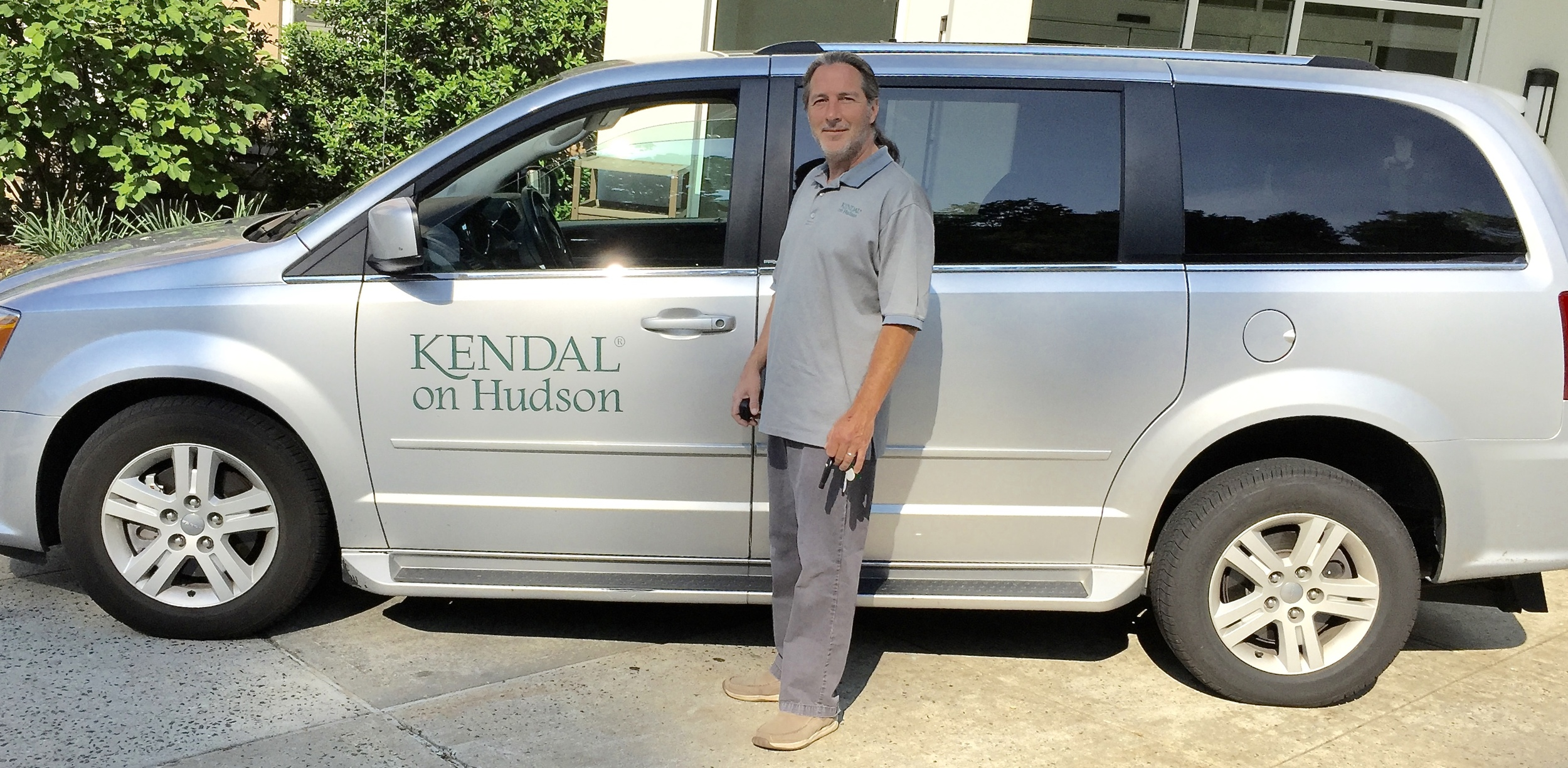 Rich Shields, Kendal's driver since 2005, with one of the vans.