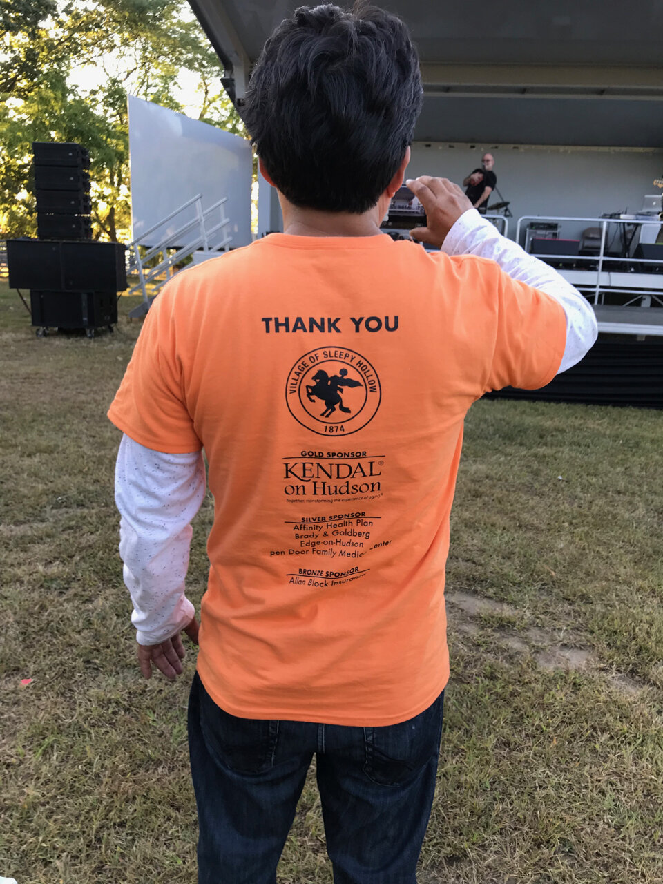 A volunteer wearing a shirt thanking Kendal for its support. - Photo by Rita Benzer