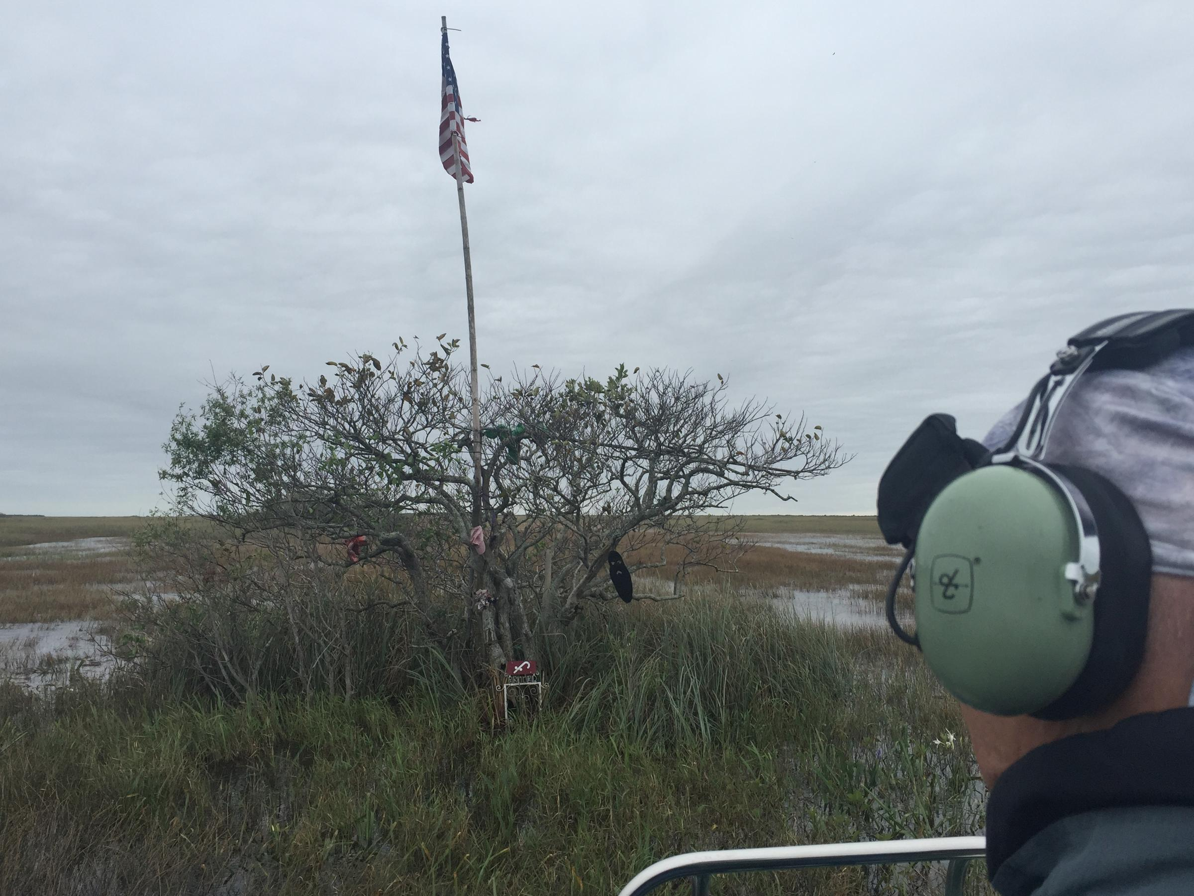 Carter Burrus looks from his airboat at a memorial site for Gladesmen inside the East Everglades Expansion area. Photo by Topher Forhecz