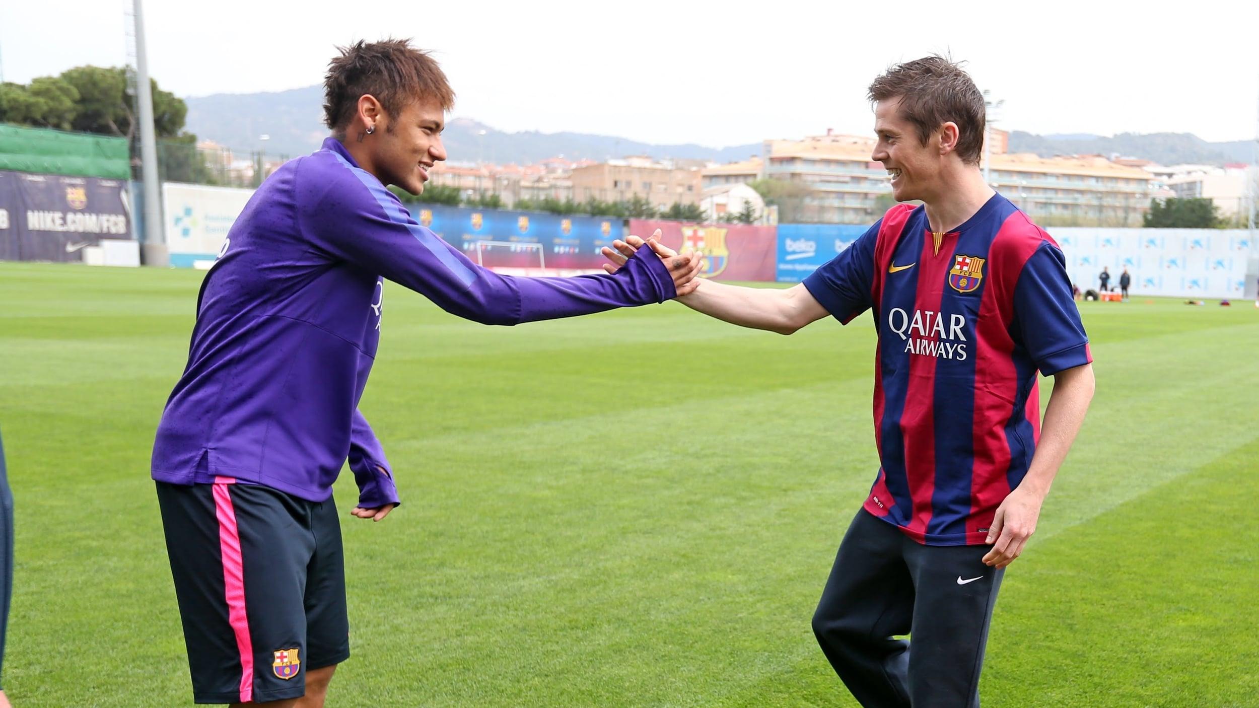 John teaching Neymar JR a few tricks at their videoshoot for BARCA TV last summer