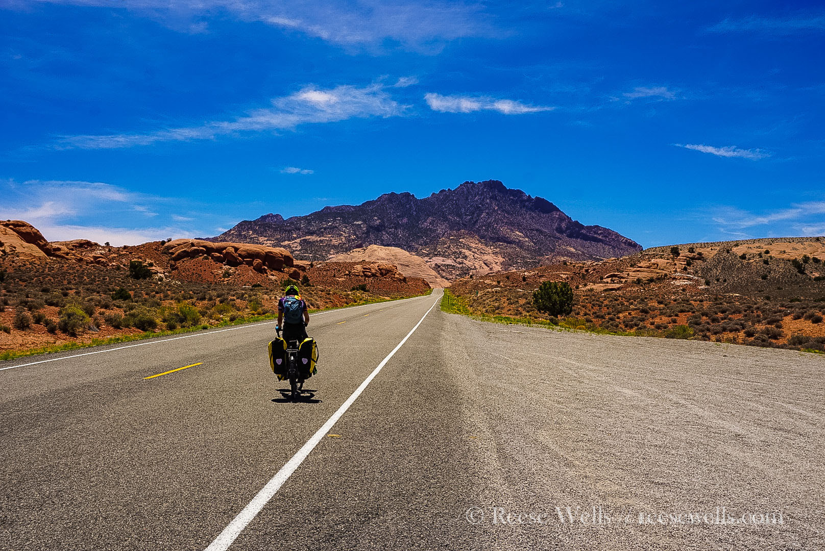 Mark riding to meet the Henry Mountains near Capitol Reef National Park, Utah