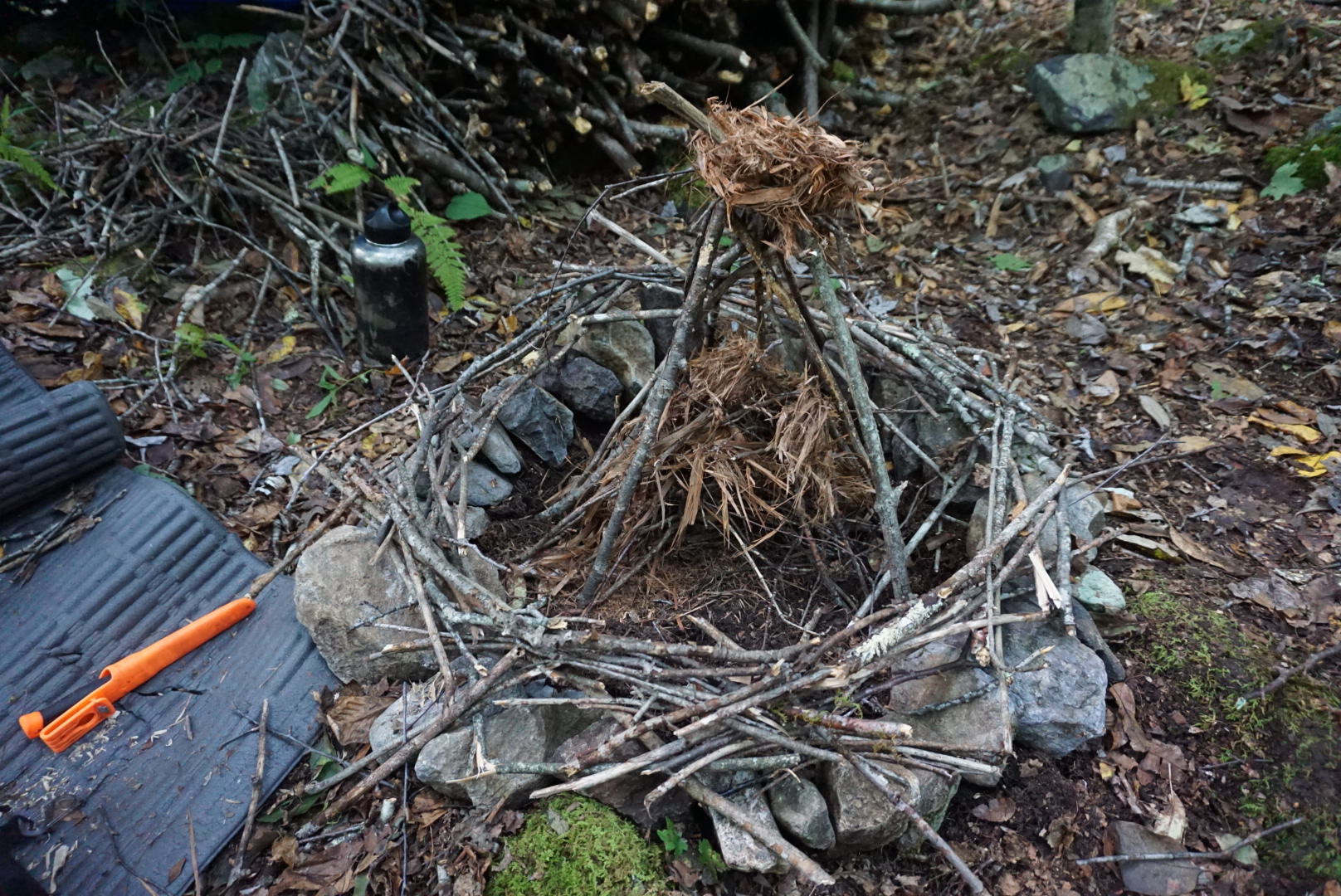 My fire house, with dried juniper wood nesting for kindling.