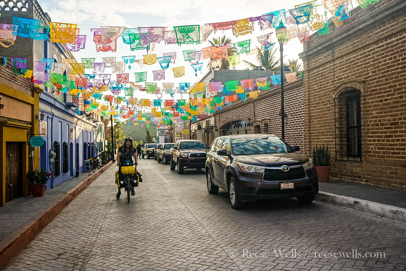 Tyler biking out of Todos Santos. This was one of my favorite streets in town.
