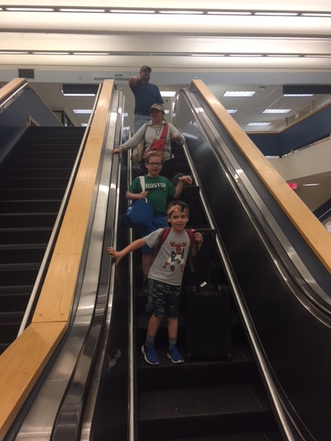 boys on escalaotr.JPG