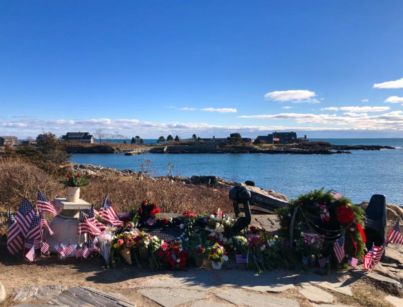 "(President Bush always called Walker Point his ""Anchor to Windward."" The floral tributes and socks placed here atop the wrought-iron anchor multiply daily.)"