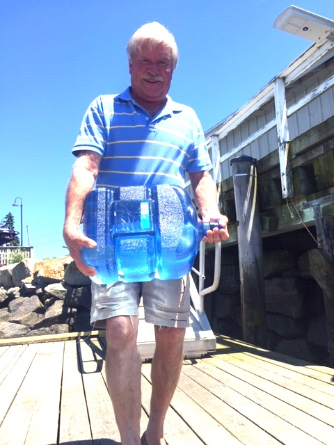 Scott Dombrowski hauling a carboy full of water to take by boat out to Goat Island for drinking water.