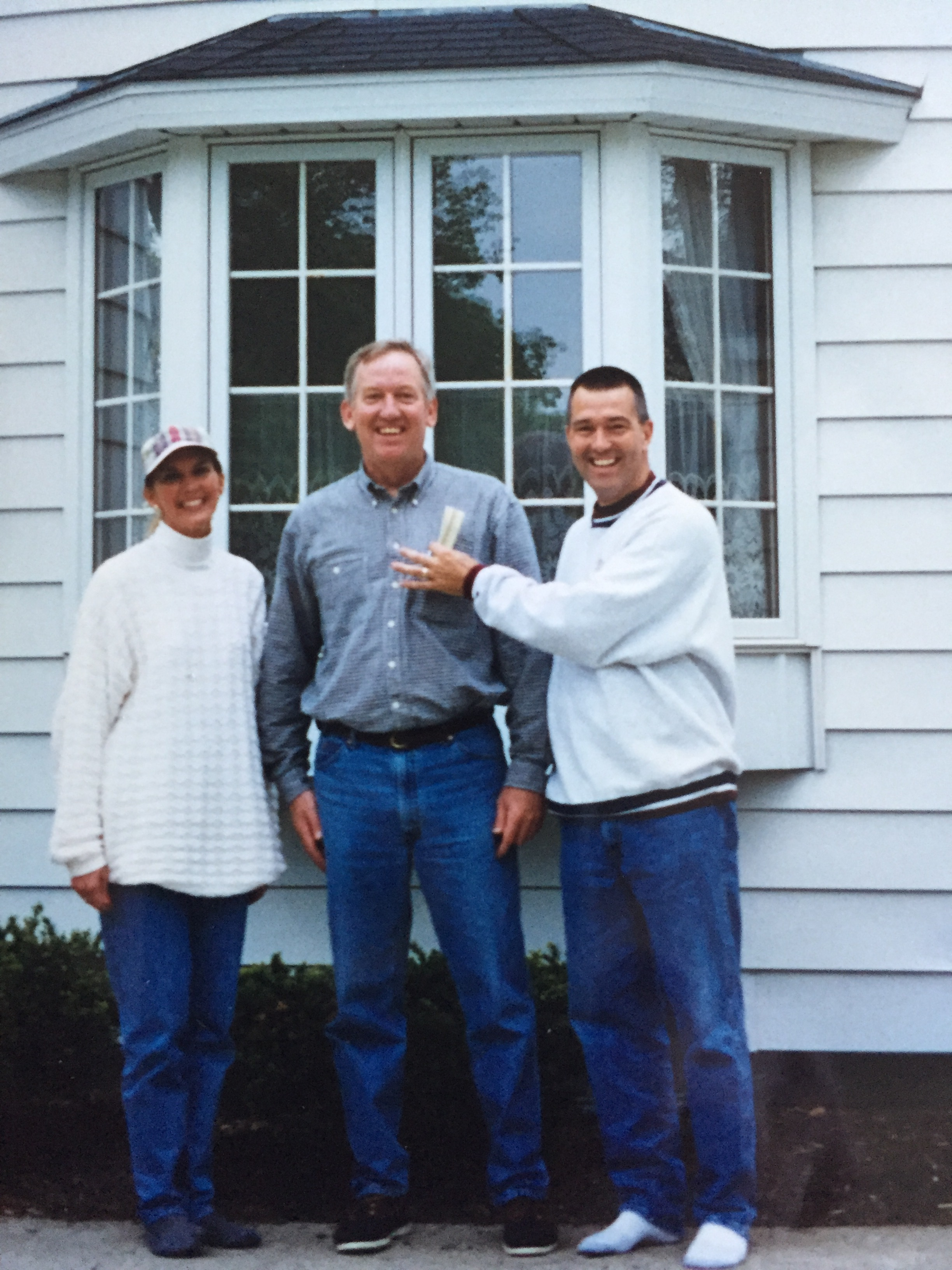 """The guy in the middle? Our realtor, whose catchphrase was """"Oh, my achin' BACK!"""" Also, where are Jeff's shoes??"""