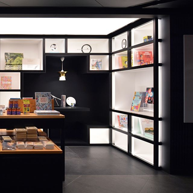 MoMA Pub at MoMA Design Store, Hong Kong. The #MoMAPub houses all the MoMA publication and exhibition material. The bespoke book shelf, which duals as a furniture wall, is a statement piece converging the best of the MoMA identity and local practicality. The incorporated seating space for readers is a twist on the tight seating in local cafes -  the cha chaan teng. #edgedesignhk #edgedesign25 #momadesignstorehk