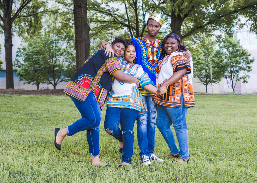 A family photo session at a local Charlotte park. The vibrant colors of their outfits helped them to stand out against the green, making a lovely, lively family photo.