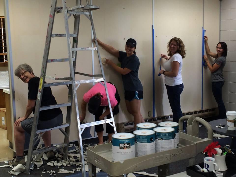 Volunteers work side-by-side with their neighborhood high school's principal.