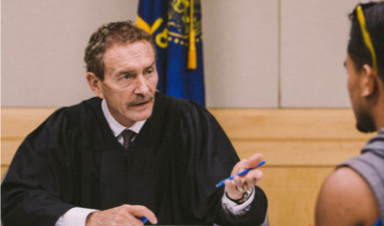 A judge outlining next steps at Community Court (Eugene Weekly)