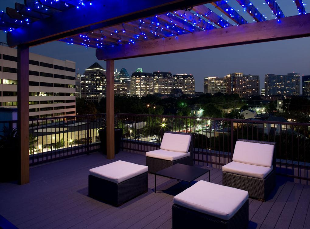 NIGHT ON THE ROOFTOP DECK