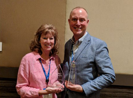 Piper Ayala, Vice President, and Brad Burleson, Operations Manager, ExecuStay and Oakwood Midwest receive the two awards during the CHPA Annual Conference