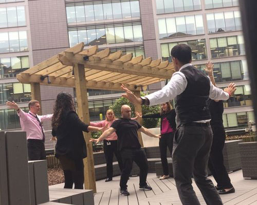 Group qigong for wellbeing class in the workplace.jpg