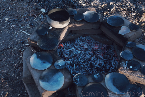 Carrying on traditions (Johnny speaking)  There is this magic of doing things the way your ancestors did them. A way of connecting to these people and times that are slipping from our lives. All of the vessels are fired in a pit, with cedar from the woods near by, done in the old ways.