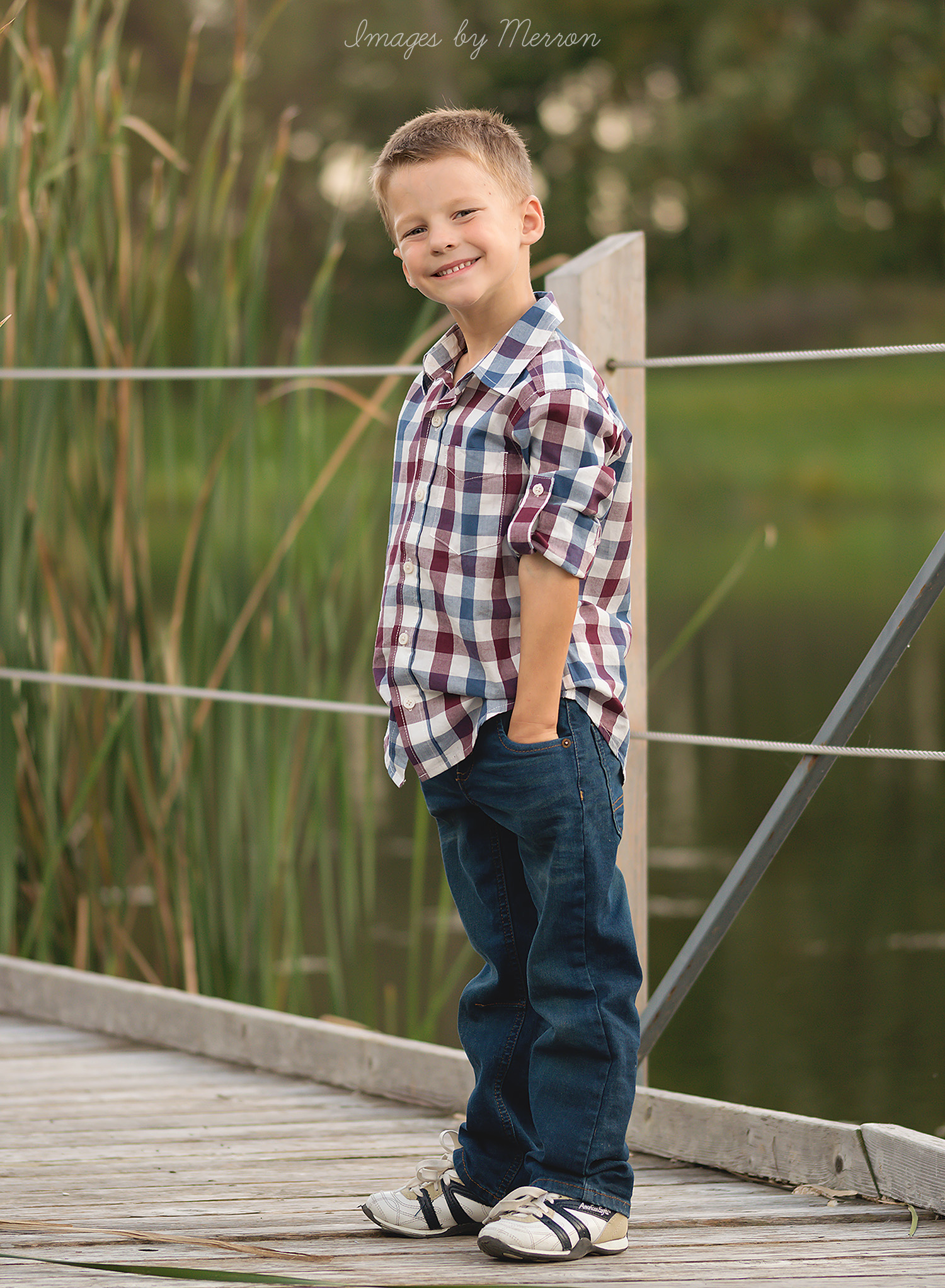 Young boy posing for his photoshoot at Jester Park in Iowa