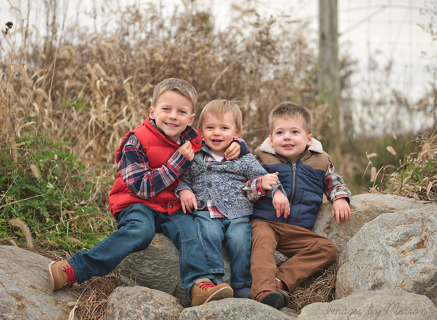 Three young boys posing for fall photography session at Jester Park in Iowa