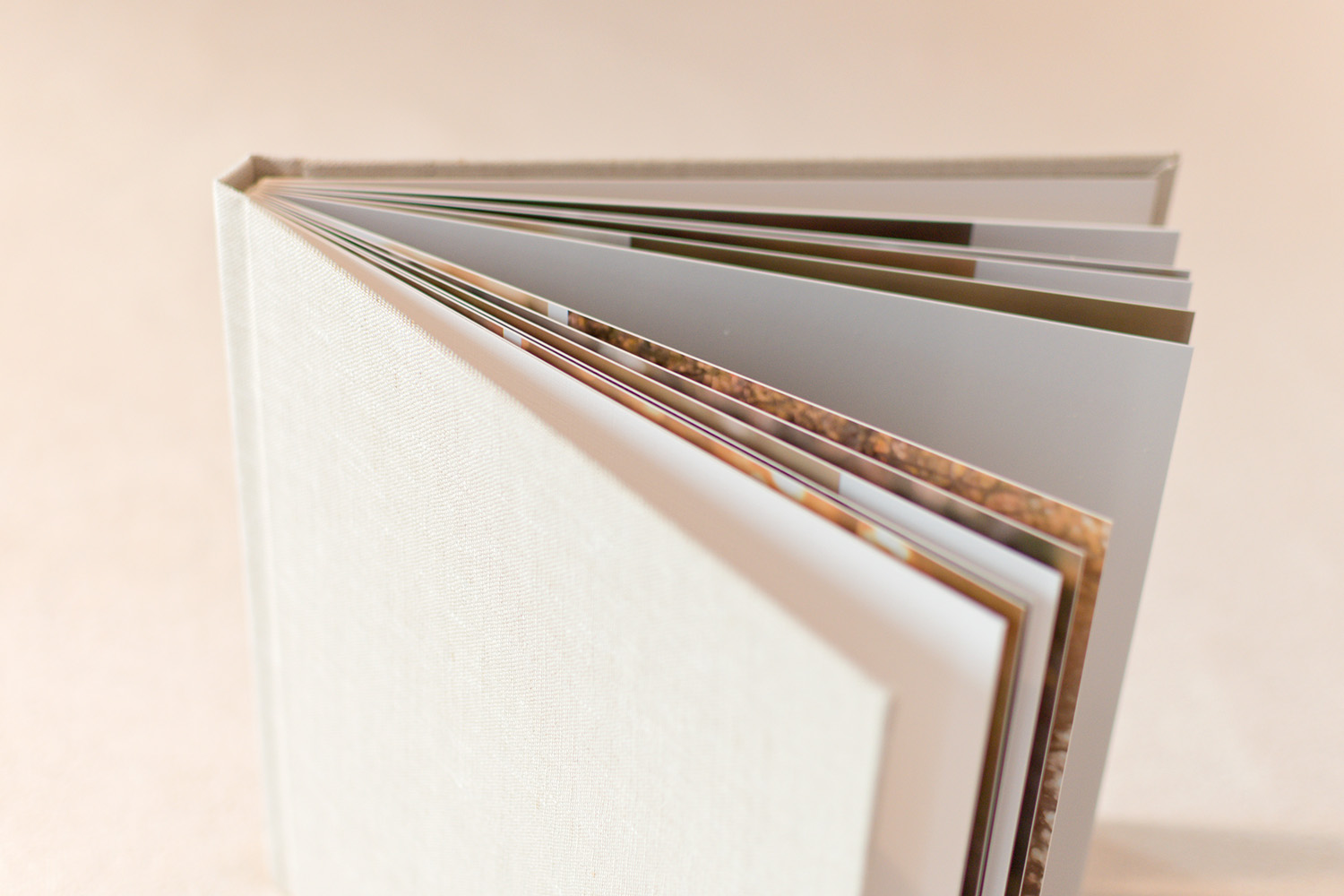 Photo album with thick pages and sand colored linen cover