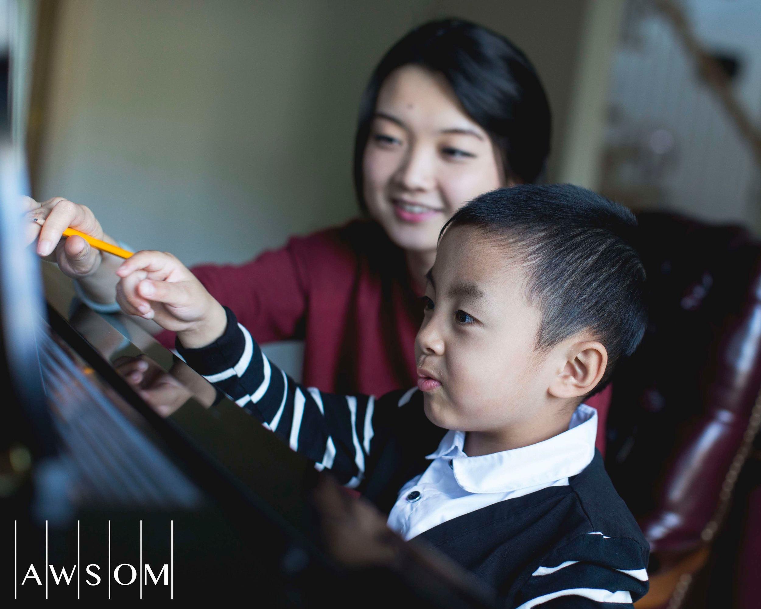 One of our AWSOM music teachers, Yusi Liu