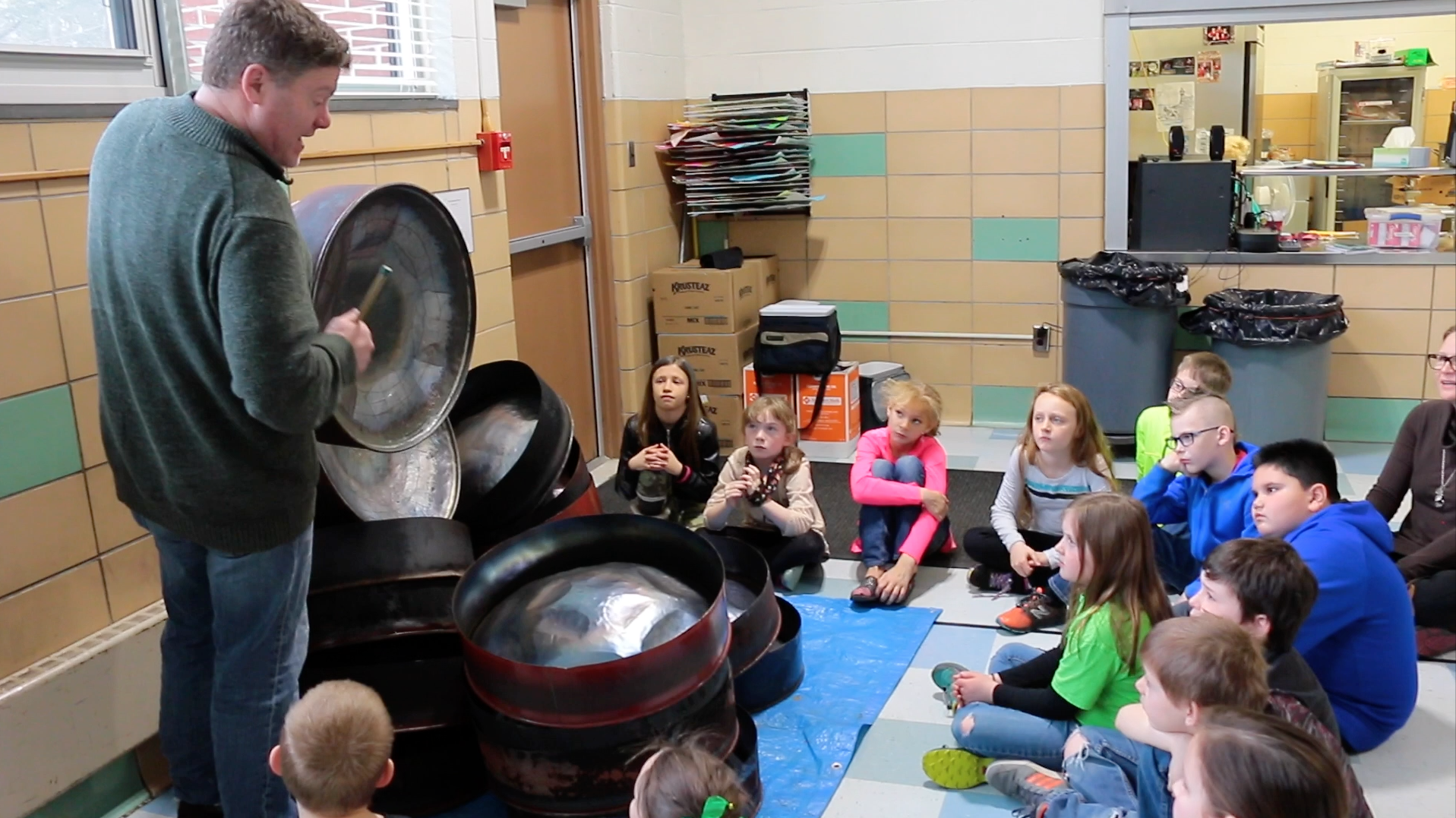 Instructor, Kevin Martin teaches elementary students the art of steel drum-making.
