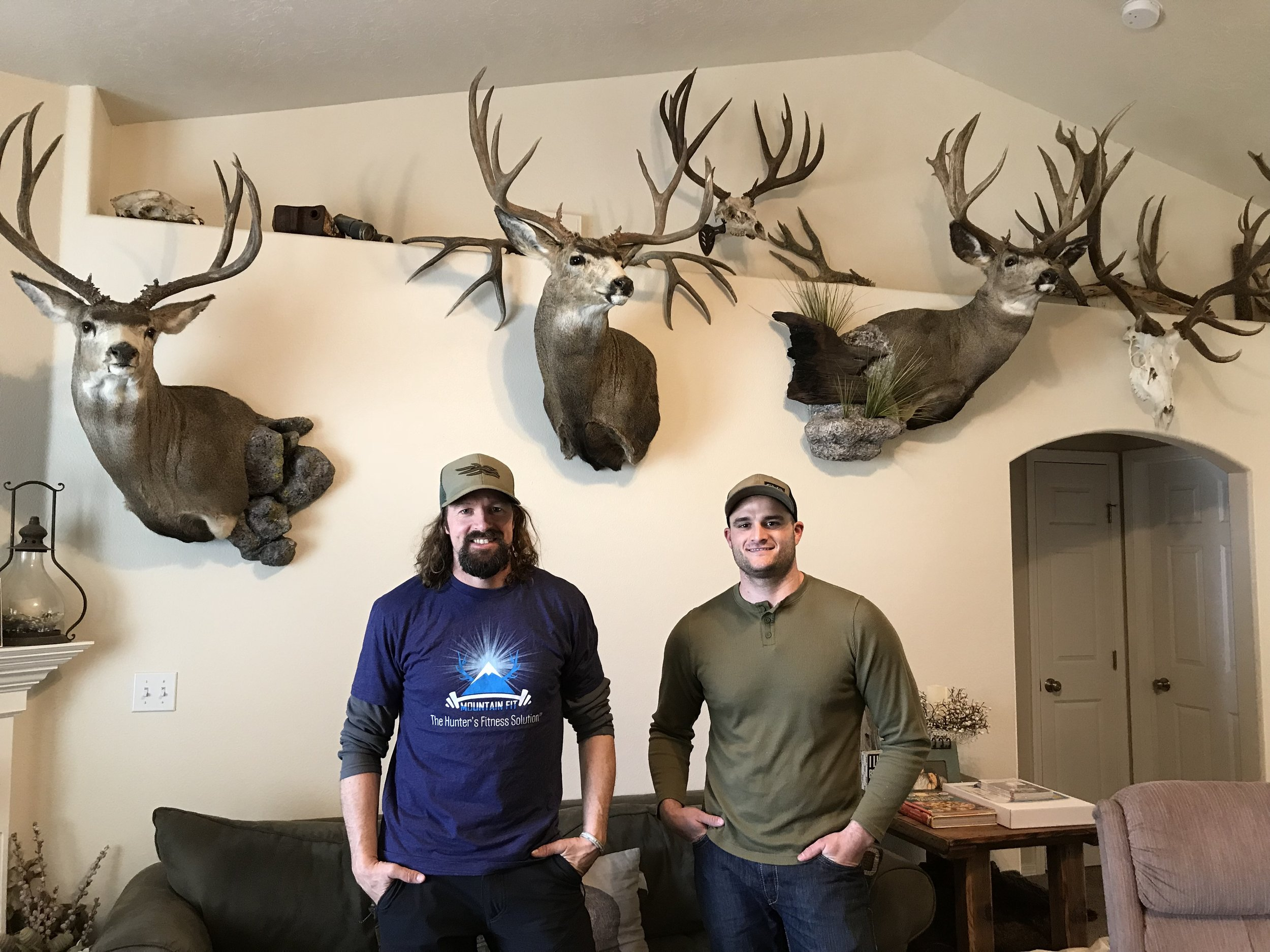 Ryan and Dioni in his home with his favorite mule deer.