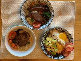 Food variation with elk burger, elk heart, and eggs.
