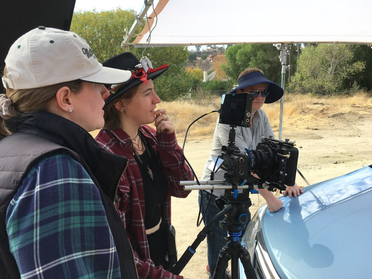 Director Kate Ketcham, Cinematographer Kyah Cook, and Producer Cameron A. Mitchell on set.