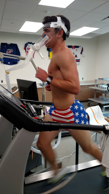 A triathlete running at max speed on the treadmill
