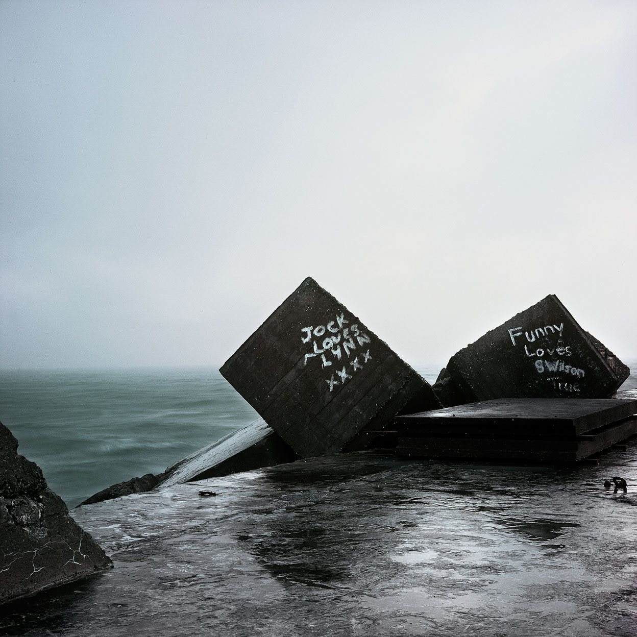 Selected works from the  SEAVIEWS Series,1977–2010   Tiphead, Greymouth, 1992   At the water's edge these gestures in concrete, bitumen and steel mark a boundary between two worlds. One is solid and secure beneath our feet, the other is manifestly in flux....   more
