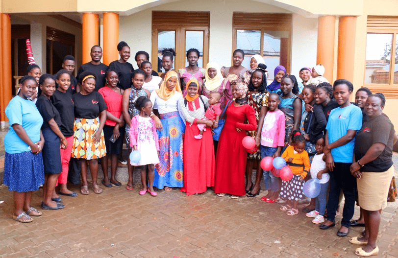 (Photo: GUIU staff and Mazuri seamstresses together with SoF graduates and their families)