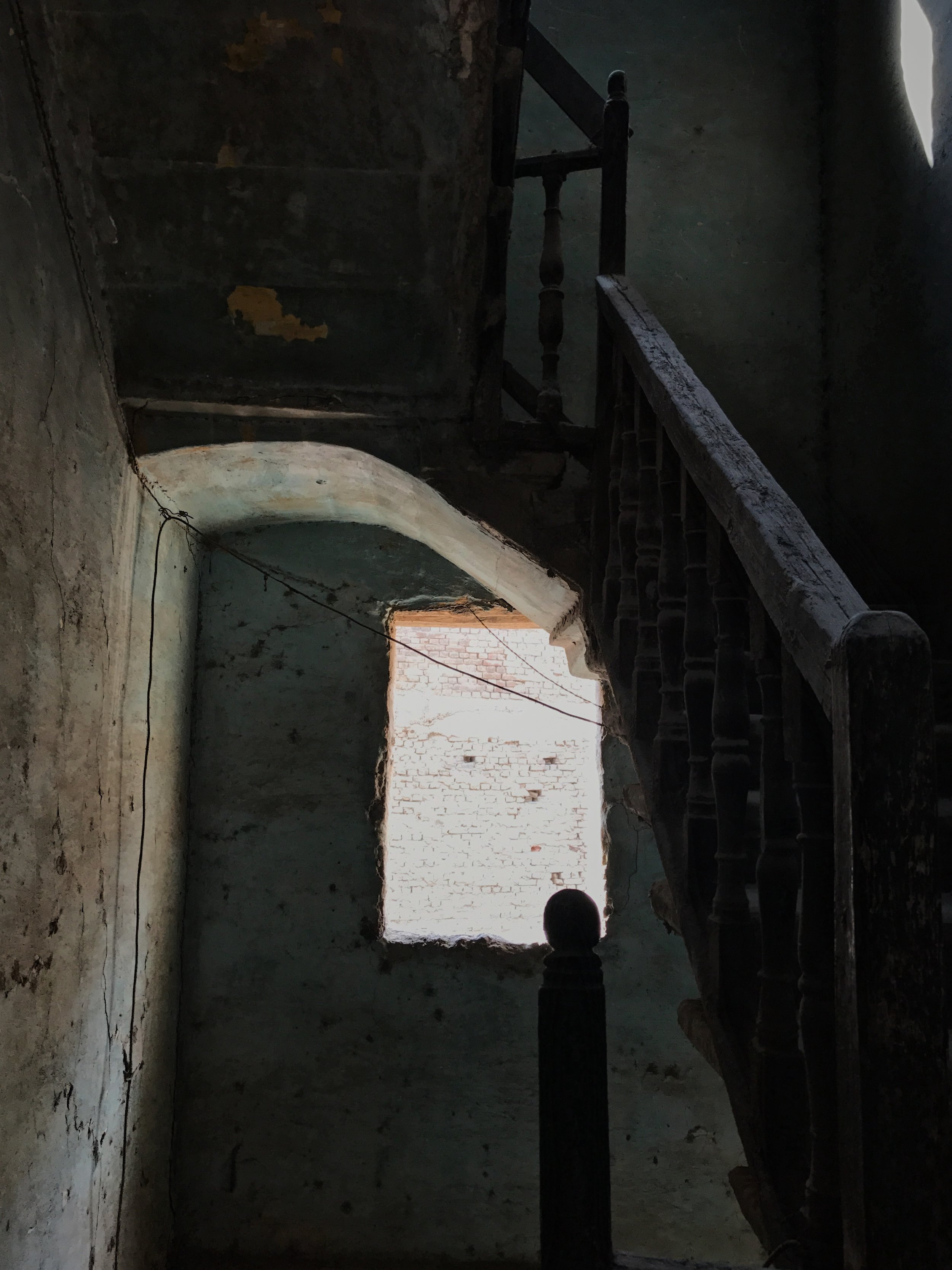 A shot of people escaping a fire...fleeing with their life and taking what their hands can only grasp... leaving behind a lifetime of memories.  Going up the aged stairs that can barley hold the burden of itself let alone trying to hold burdens of others...