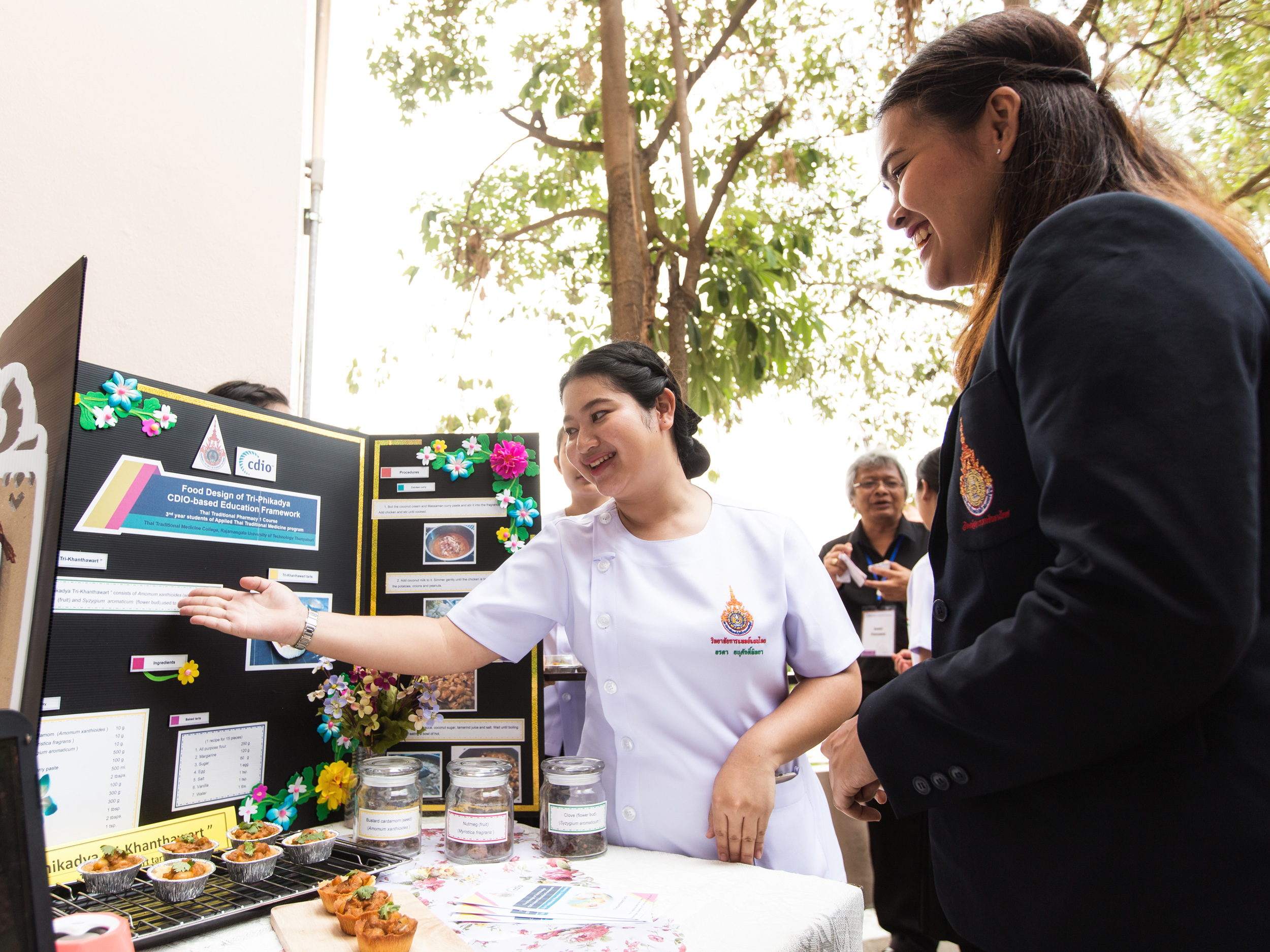 Thai Traditional Medicine College student Orada Anusakpitaya (left), 20, presents her project, where she used traditional herbs to make tarts. Orada not only conceived the idea of healthier pastries, she also convinced her classmates of it through presentations, which trained her communication skills.