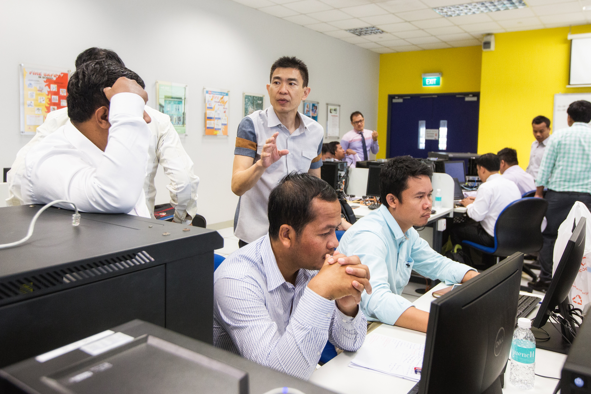 Desmond See (centre), 50, a senior lecturer from Singapore's Institute of Technical Education (ITE) College East, explaining the steps involved in setting up, configuring and testing a small network.