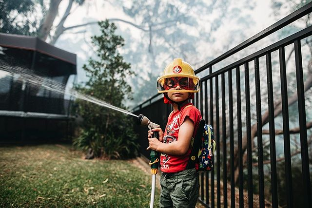 My little fire fighter. He was super excited when back burning happened right at the back of our place. We were all excited...until we got smoked out and had to stay at the in-laws for the night.