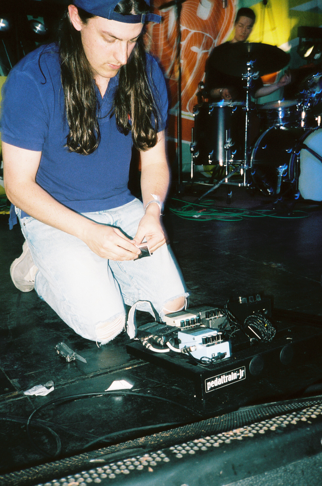 Tommy dialing in his guitar tone and setting up his pedalboard