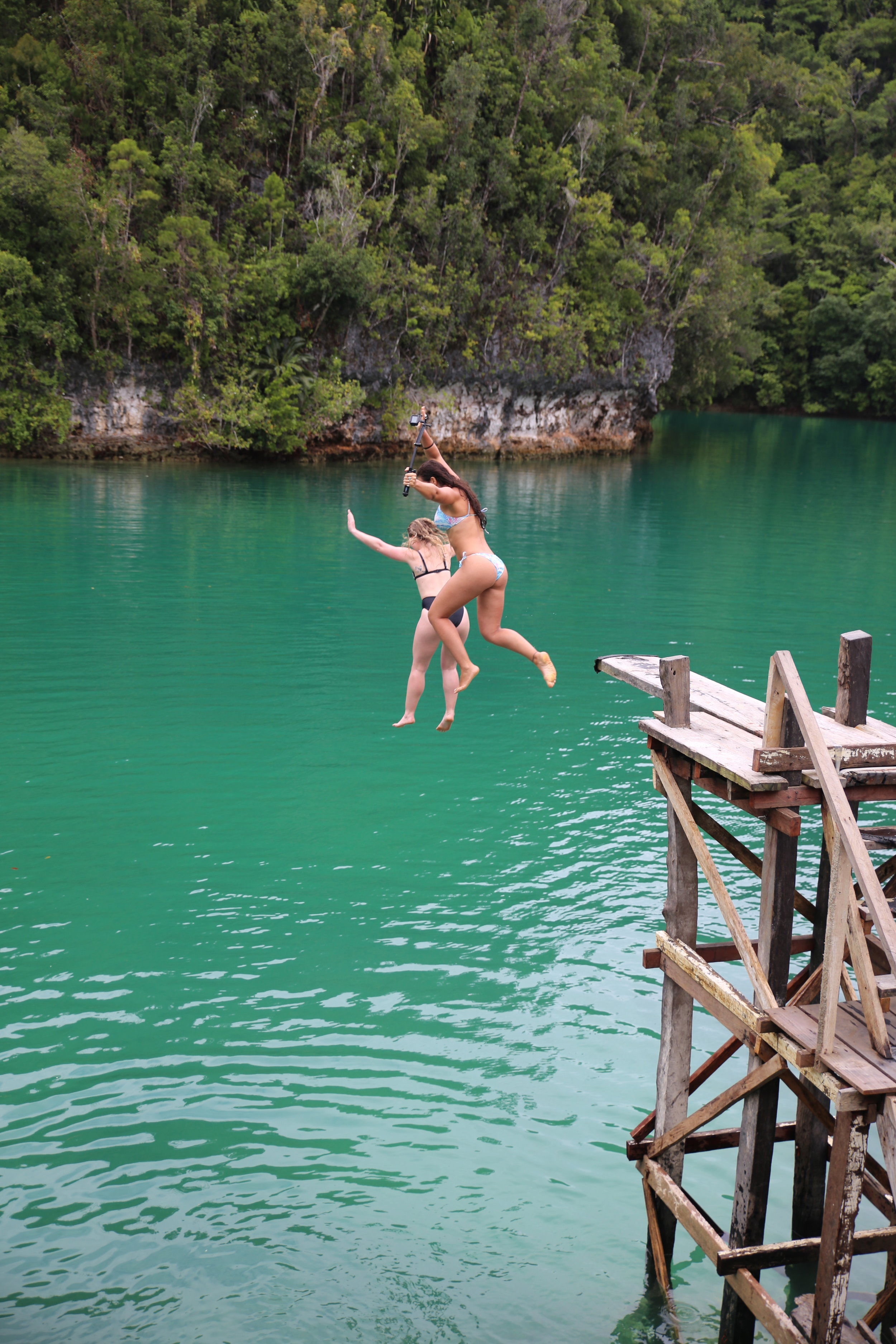 sugba lagoon jumping in the water