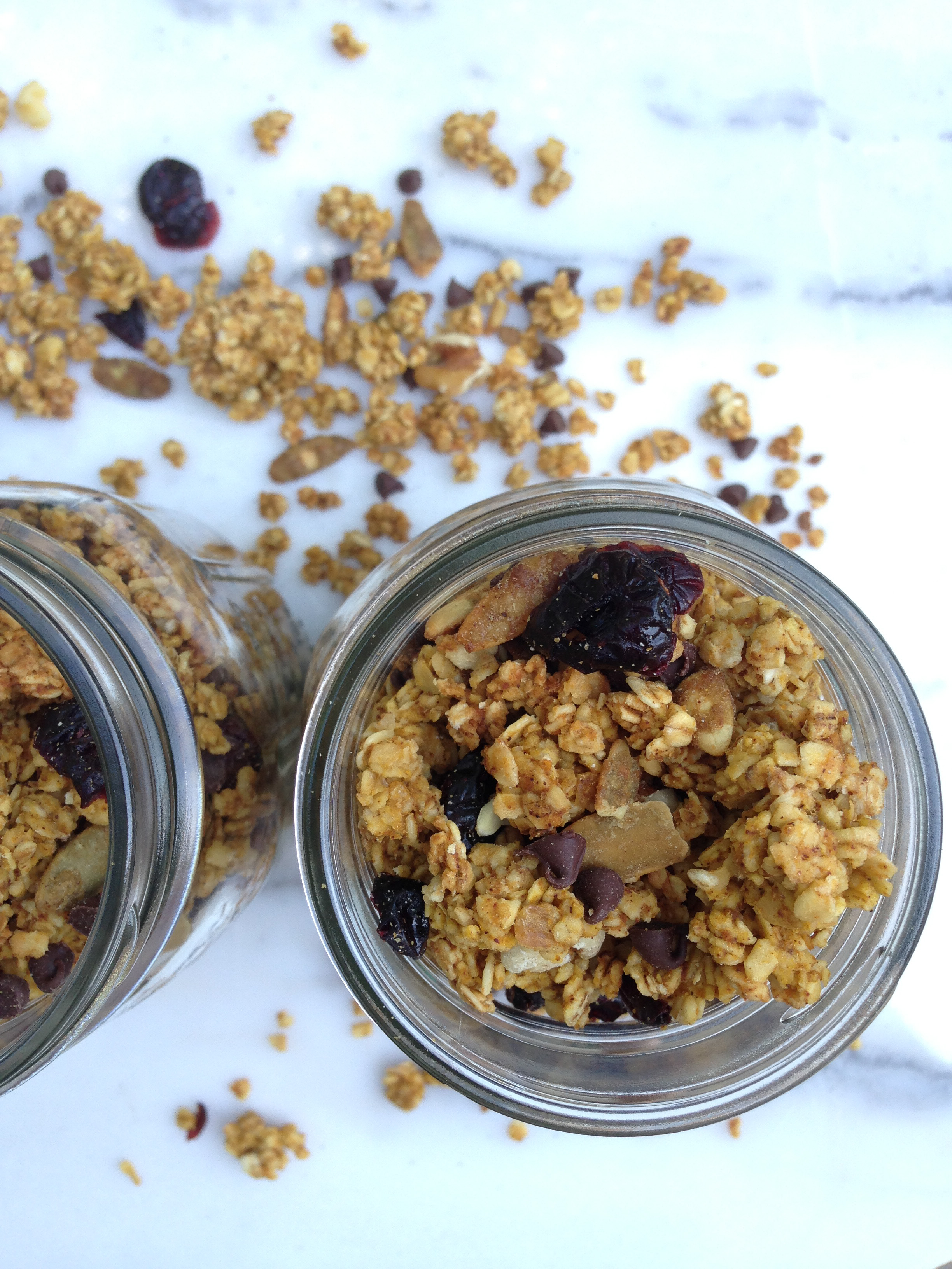 Gluten free pumpkin granola filled with pumpkin seeds, mini chocolate chips, dried cherries, and chopped walnuts.