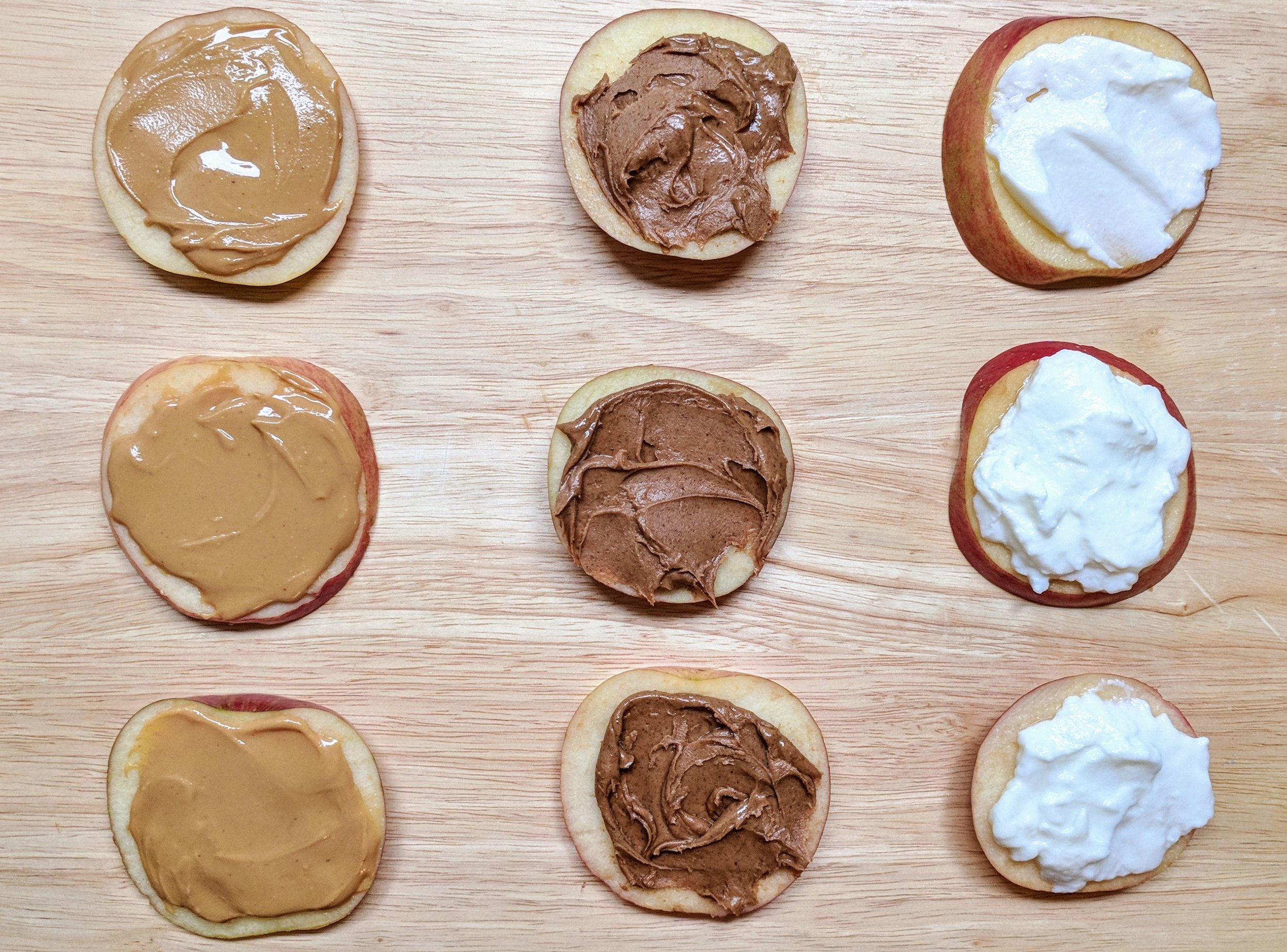 Several of my favorite toppings for apple slices include natural peanut butter, almond butter, and Greek yogurt.