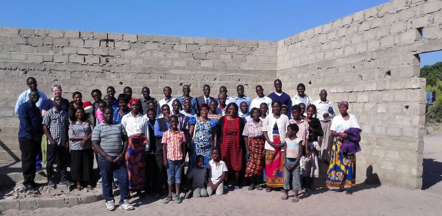 Pastor Yuyi's congregation celebrating worship in their under-construction worship center, Mongu, Zambia