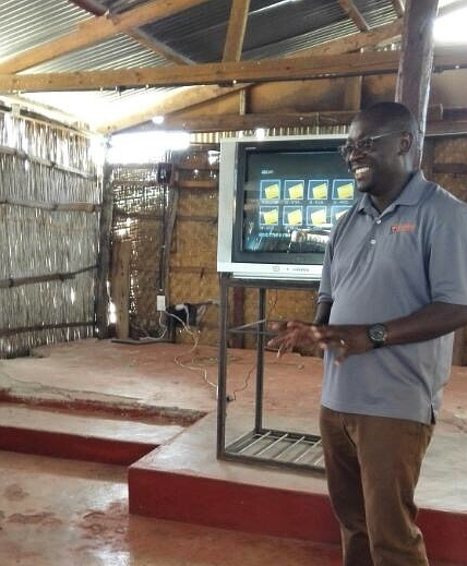 Pastor Percy utilizing the Live School training video.