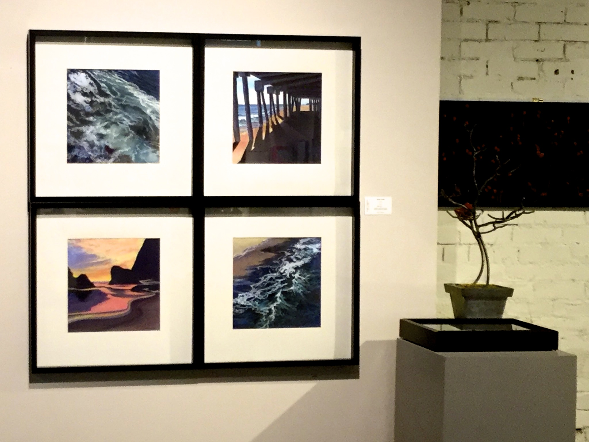 "Four paintings from Ginsburg's ""Ocean Series"" displayed together."