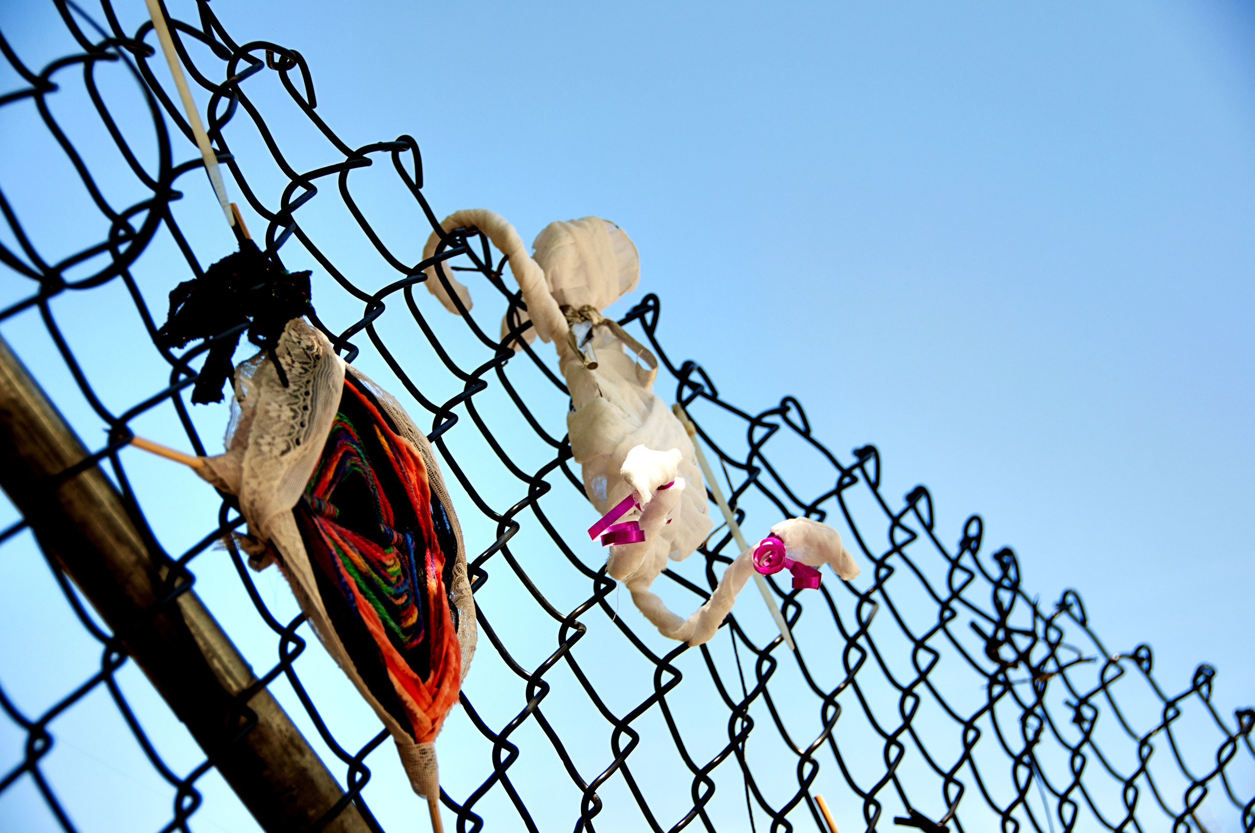 Ghost and knit art on Carrboro Fence - Weaver Street & N. Greensboro Street