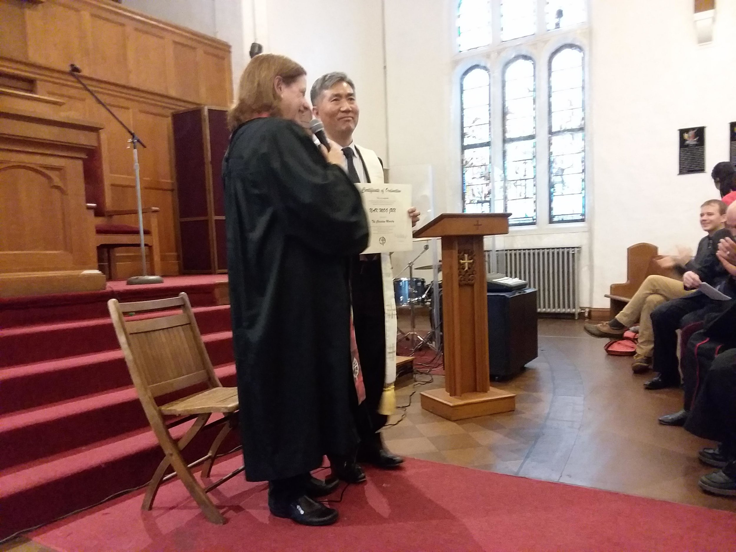 David Nakmoo Jun received his ordination certificate from Mary Day Miller, executive minister of TABCOM.