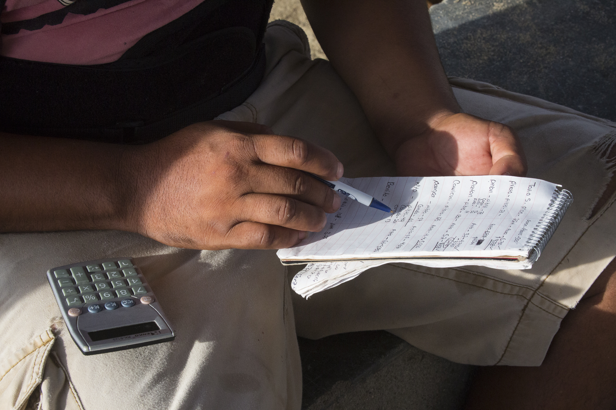 A member of the cooperative writes down data from the day's catch: weight, species, and who caught them. This data is used by them for pricing their products, but it is also used by researchers who study shark populations and authorities who seek to regulate the trade.