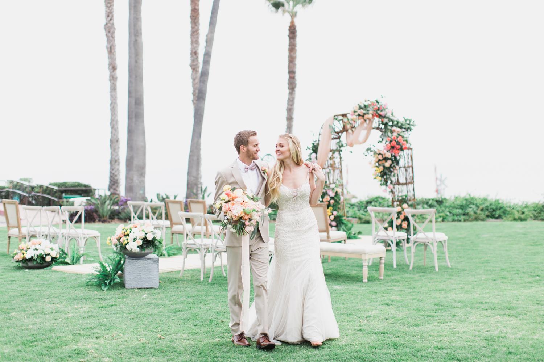 Bride and Groom at Ole Hanson Beach Club wedding in San Clemente, Ca with wedding photographer Lovisa Photo.