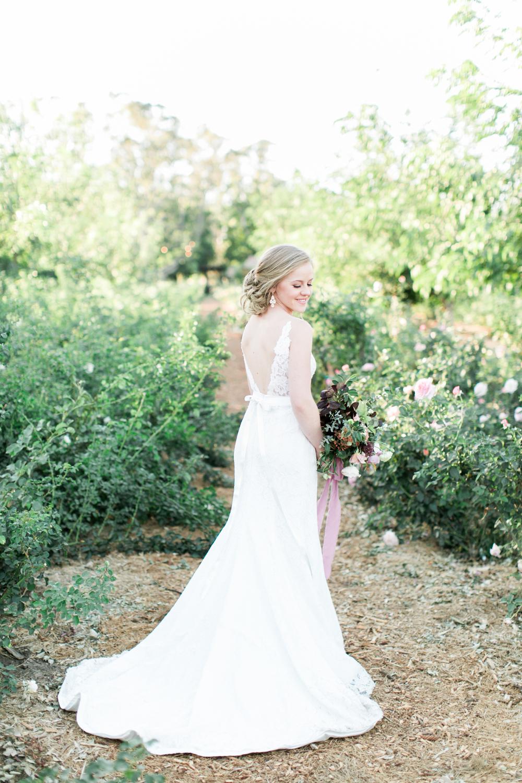 Bride gets ready for wedding photos at Walnut Grove in Moorpark, Ca.