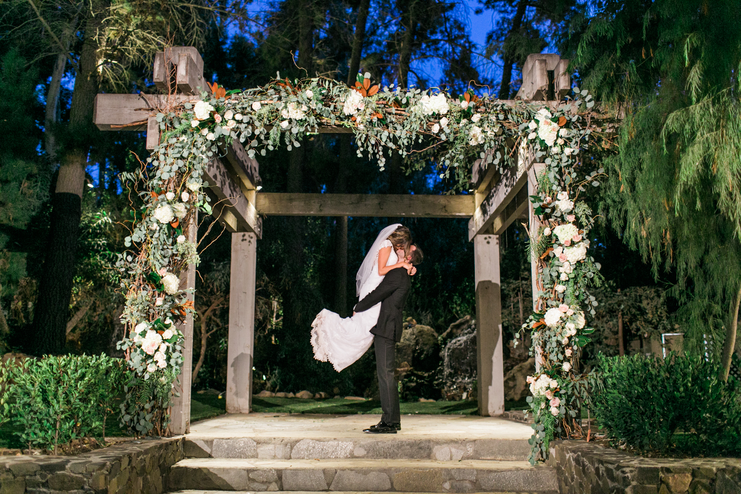 Bride and groom kiss at Calamigos Ranch wedding at the Redwood Room.
