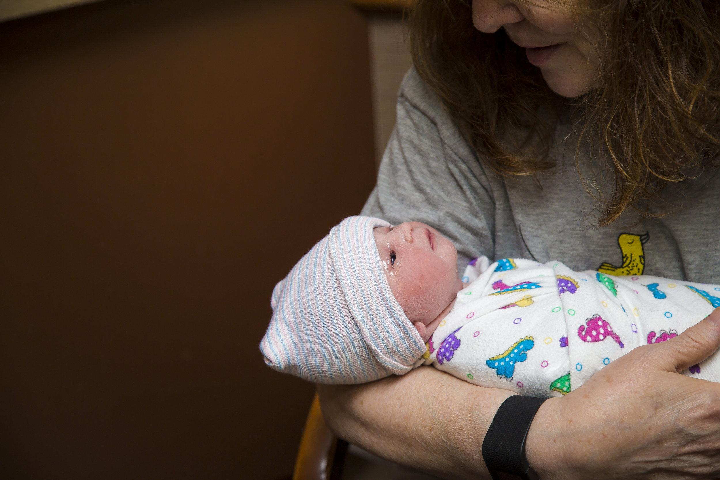 newborn baby with grandma.JPG
