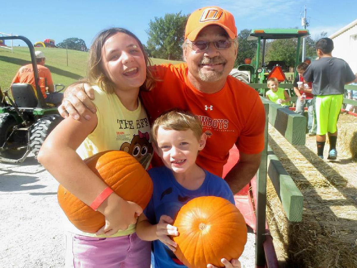 Dans family with pumpkin.jpg