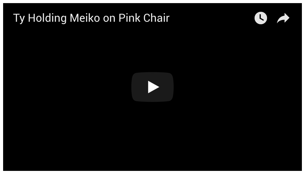 Ty holding Meiko in Pink Chair